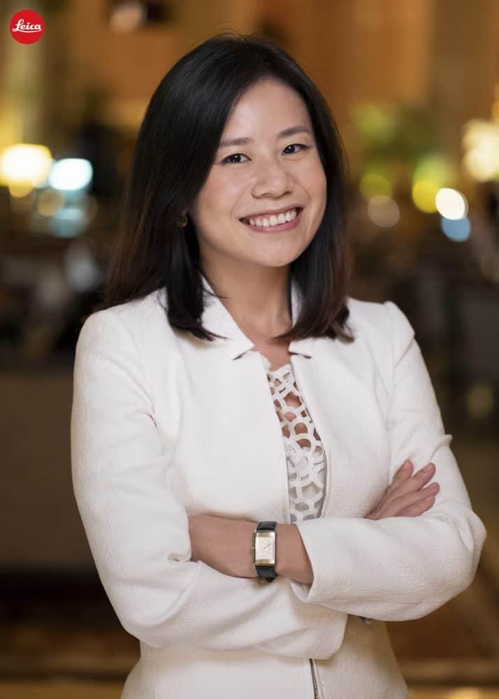 Shen Xiaoyin ReSET woman arms crossed smiling