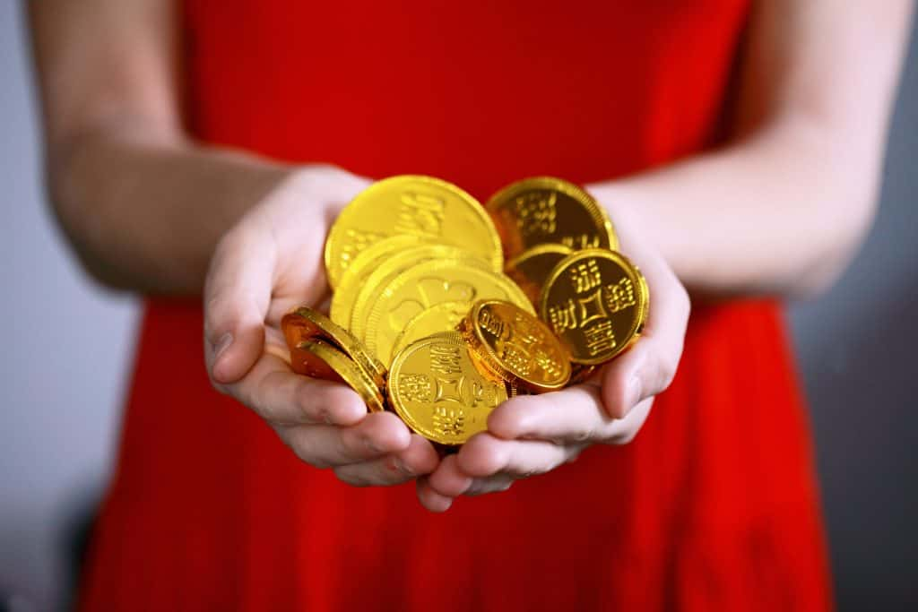woman red dress coins