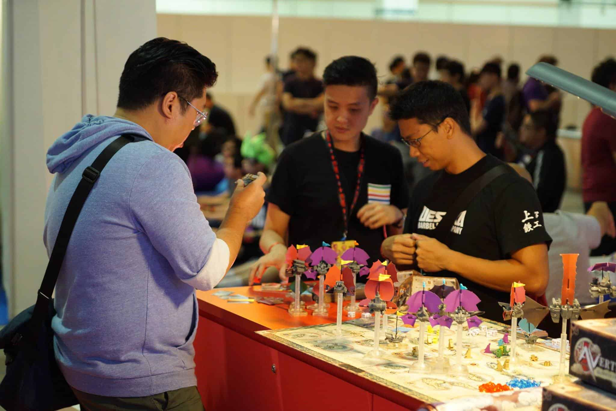 People checking out Avertigos at Singapore Toy, Game and Comic Convention. Source.