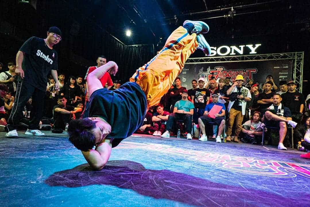 Breakdancer male on elbow in dance battle