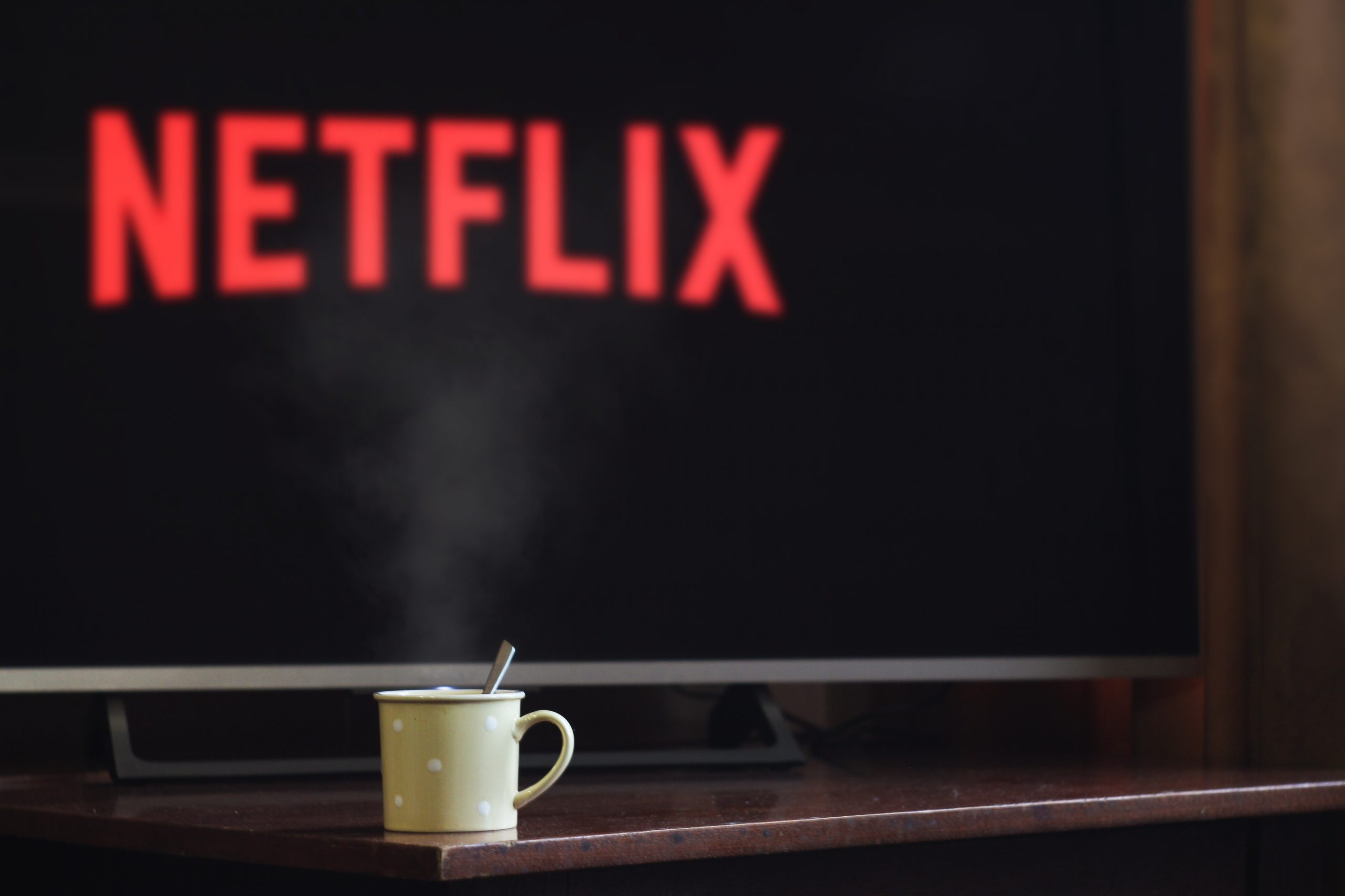 Coffee mug and Netflix in front of TV